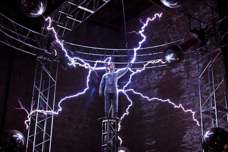 David Blaine stand atop a 24 foot pillar while being struck by 8 Tesla coils.