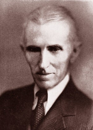 Tesla poses for a picture as an older man.