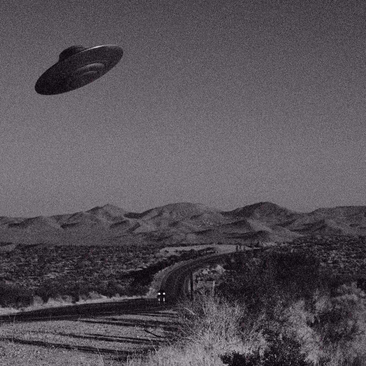 A UFO zips through the sky.