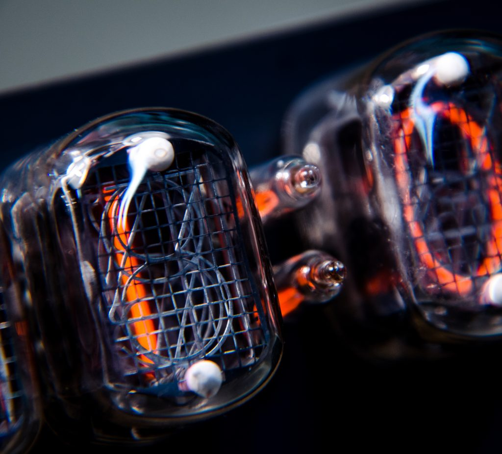 close up of nixie tube displaying a digit